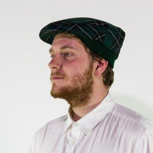 Modelled tartan flat cap