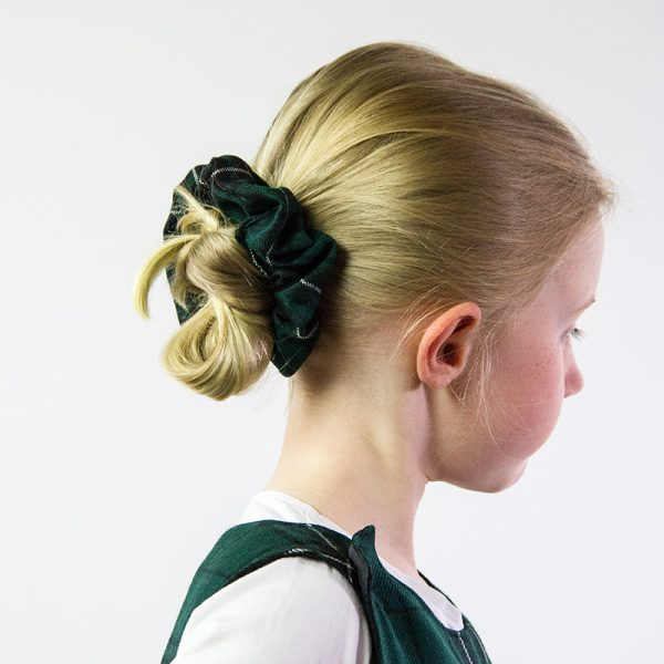hair tied back with green tartan scrunchie