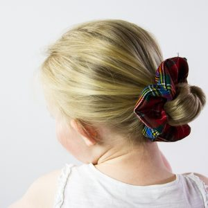 hair tied back with tartan scrunchie