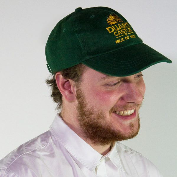 model wearing a green Duart Castle baseball cap
