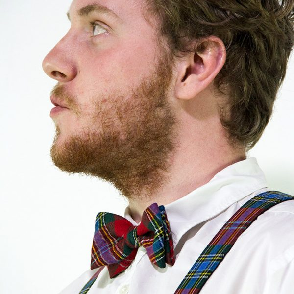 model wearing tartan bow tie