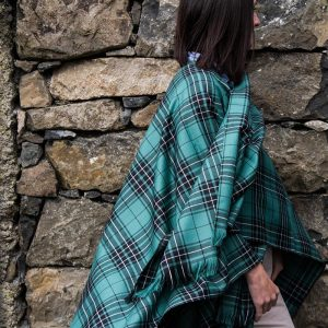 Maclean tartan serape worn by model