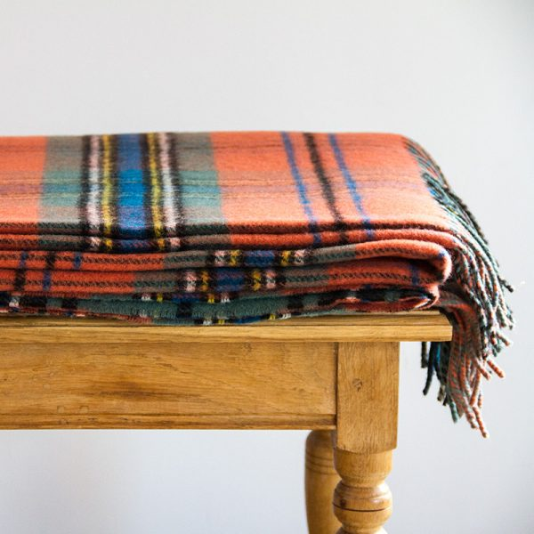 large weathered tartan rug