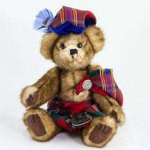 Teddy bear in tartan dress