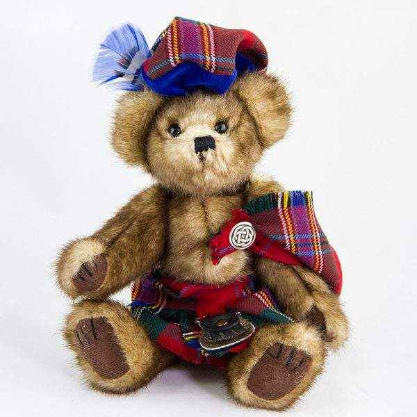 Teddy bear in tartan dress